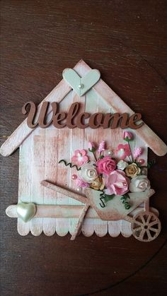 Awesome lollipop stick crafts for valentines Welcome house in Pink's and brown's with flowers and hearts. By CAM Lolly Stick Craft, Popsicle Stick Crafts For Adults, Ice Cream Stick Craft, Popsicle Stick Art, Popsicle Crafts, Craft Stick Crafts, Craft Sticks, Resin Crafts, Diy Arts And Crafts