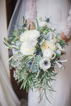 Winter wedding bouquet idea - white, blue + green bouquet with roses, ranunculus, succulents, anemones, thistle and dusty miller {Conforti Photography LLC}