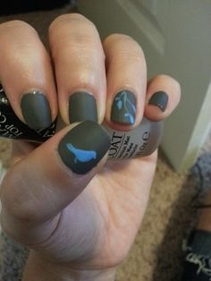 gorgeous matte nails with little blue bird and branches by Reddit user BabyOnHip
