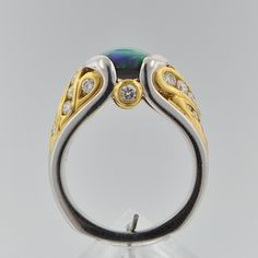 561. An Amazing Fiery Black Opal, Platinum and Diamond Ring - November 2009 Auction - ASPIRE AUCTIONS