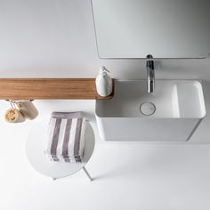 The Falper Lavamani Wall Hung 300 Rectangular Washbasin is designed especially for bathrooms of modest dimensions. The piece is manufactured in Ceramilux, an innovative material used to enhance the appearance of the washbasin, allowing unprecedented levels of slenderness. Various compositions are available because the washbasin is complemented by optional accessories - Iroko timber shelves and curved square tube toilet roll and towel holders.