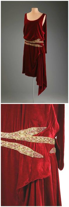 Evening Dress, by Thurn New York, 1920-5, Hillwood Estate, Museum & Gardens. Tubular one piece sleeveless evening dress in red velvet. Trimmed at waist with two bands of metallic gold thread with red glass beads, gold painted strung beads and rhinestones. A decorative sash begins at back left shoulder, is caught at waist and extends beyond hem. The dress is open on left side below waist to reveal the attached silk crêpe slip. Slip has flesh colored tulle straps and is edged along top in…