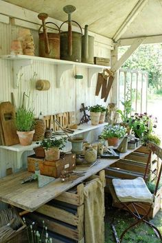 Potting shed - potting table made with pallets and plank of wood. Could use an old door.