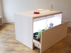 Reduce food miles and grow your own with this hydroponic kitchen island at Model Citizens for NYC Design Week