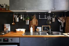 Fanny and Fabien, Paris 20ème | Love the hanging utensils rack #kitchen #organization