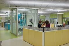 A view of the ED captures open and closed collaboration spaces for staff, all easily visible to other staff members, patients, and families while also just steps away from patient rooms. Seattle Children's Hospital. Credit: Benjamin Benschneider.