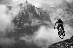 This photo was made in Photoshop. I think it they used the black and white tool to make the image black and white. They may of also darkened the biker to make him stand out more.