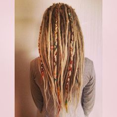 Dreadlocks with yarn braids as decorations More