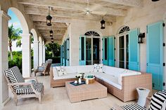 not crazy about the furniture but i love the blue shutters.