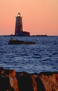 Whaleback Light, offshore from Kittery, Maine.  Whaleback Light is owned and operated by the town of Kittery, Maine. Sitting just offshore from Fort Foster, the light was positioned to protect the Portsmouth, NH harbor. by margo