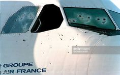 Bullet holes in the windows and fuselage of an Air France Airbus A-300, which was hijacked from Algiers, testify, 27 December 1994, to the violence incurred during the plane's liberation at Marseille-Marignane airport on 26 December 1994. Gendarmes from the GIGN intervention unit stormed the plane, 26 December 1994, freeing 170 passengers and crew members and killing four Algerian Islamic extremists.