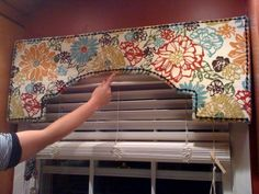 We may make a fabric covered pelmet board to cover the white wood thing that hides the drapes