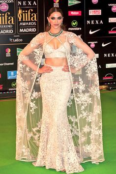 Deepika Padukone does it again at the IFFA 2016 Awards night! She looks absolutely stunning in a ivory laced Sabyasachi gown. The designer's inspiration comes from a Spanish bullfighter which… Sabyasachi Gown, Pakistani Dresses, Indian Dresses, Indian Outfits, Indian Clothes, Lehenga Choli, Desi Clothes, Anarkali, Bollywood Celebrities