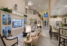 Gorgeous Toll Brothers open floor plan featuring Progress Lighting Ashbury pendants and Equinox chandelier #interiordesign