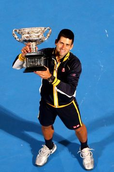 Novak Djokovic of Serbia holds the Norman Brookes Challenge Cup after winning his men's final match against Andy Murray of Great Britain during day fourteen of the 2013 Australian Open at Melbourne Park on January 27, 2013 in Melbourne, Australia.