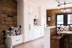 To make up for a lack of storage, we added floor-to-ceiling white custom cabinets.