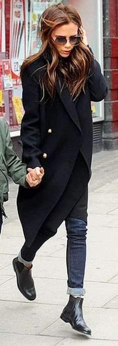 Who made  Victoria Beckham's skinny blue jeans, black coat, and sunglasses?