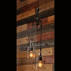 This pulley pendant lamp can be made with any two bottles of your choice, whether they be wine bottles or liquor bottles. Just let us know if you have something else in mind, other than the square bottles, pictured. The 5 round metal aluminum pulley can be finished in black, oil rubbed