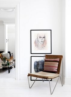 Love the chair and the low hung art