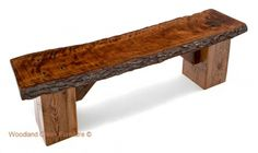 This thick slab bench features a natural live edge plan and a reclaimed barn wood base for a unique rustic bench available in custom made sizes. Made in USA