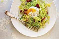 Want to eat eggs like they do in France? Try making frisée, poached egg, and bacon salad.