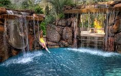 Spectacular backyard with pool/spa , abundant waterfalls, fire pit and slide.