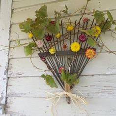 Rake with fall foilage for outside decor. (Don't especially like this example, but the rake base is great!)