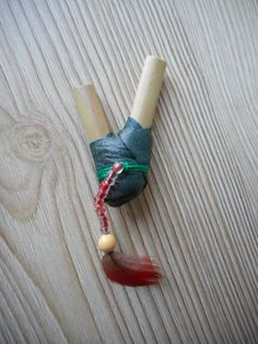 Green kuripe with leather, glass beads, seed and red parrot feather. www.facebook.com/MotherofWater