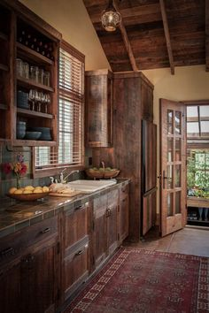 Love the countertop color.  Blends perfectly with the rustic wood cabinets. Love the open shelving. Shilo Ranch Compound - Interior
