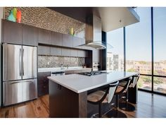 Beautiful gourmet kitchen in a luxurious loft with sweeping views of downtown Minneapolis | 618 Washington Avenue N 607, Minneapolis, MN 55401