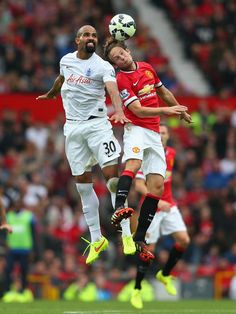 Sandro of QPR against Daley Blind of Manchester United