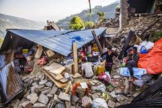 36 year old Sonal Tamang (center) runs her grocery shop from a broken building in the village of Baruwa in Sindhupalchowk. The local population may have the resilience to overcome this disaster. All they need is our support. http://bit.ly/1do2za0 Photo- Prashanth Vishwanathan/CARE