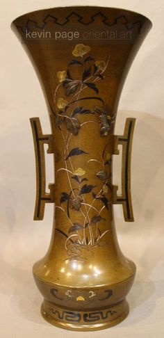 A Japanese bronze vase with inlaid decoration