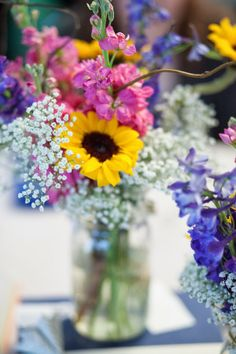 Really pretty... different wild flowers in a simple vase to add color without being too much.