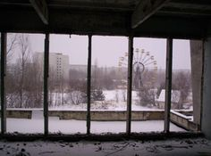 View of the Pripyat ferris wheel from one of the devastated apartments