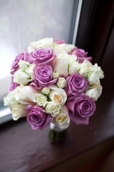 Stunningly elegant cathedral wedding with a purple & white bridal bouquet #rosebouquet