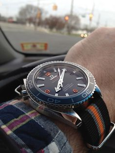 """Omega Seamaster Planet Ocean (PO) (Std. size (42mm), not 'Big' PO (45.5mm) on a 20mm 'Tudor Heritage Chrono' """"style"""" NATO. (Click on photo for high-res. image.) Photo found here: http://forums.watchuseek.com/f20/just-got-my-new-omega-po-xl-need-help-finding-cool-nato-strap-summer-683309.html    This NATO is made by deBeer Paris http://www.debeerwatchbands.com/nato-nylon-watchbands.html"""