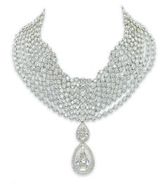 AN IMPRESSIVE DIAMOND CHOKER, BY ADLER Suspending a detachable pendant set with a pear-shaped diamond weighing 32.28 carats and surmounted by a pear-shaped diamond weighing 6.36 carats, each within a micro pavé-set diamond surround, to the eight-row collet-set diamond choker, choker 34.0 cm inner circumference, pendant 5.5 cm long, in an Adler grey leather case Signed Adler
