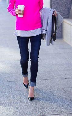 Grey tee, pink sweater, cuffed jeans, black heels