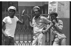 Dennis Brown, Barry Llewellyn of the Heptones and Junior Delgado outside The Boothe Memorial Hall, North Parade, Kingston May 1977.