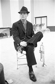 American trumpet player Chet Baker sitting relaxed in the record studio of the recording label Rca. 1961