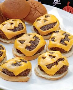 Jack O' Lantern Cheeseburgers! Love the idea! I was just thinking about some of the X-miss cookie cutters that I have and how some will fit a piece of cheese!