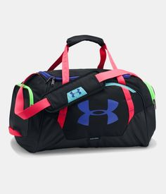 The Under Armour Undeniable Duffel features UA Storm technology to deliver a water-resistant finish, tough, abraision-resistant botton and side panels and an adjustable, padded shoulder strap for maximum comfort. Under Armour Rucksack, Pack Up And Go, Workout Essentials, Sporty Style, Pink Purple, Gym Bag, Shoulder Strap, Purses, Side Panels