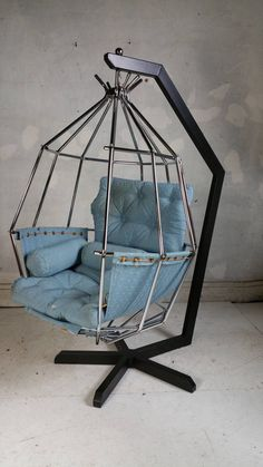 Hanging birdcage or parrot chair designed in 1970 by Swedish designer Ib Arberg, the angular black metal stand securely holds the chromed steel hanging birdcage chair, cradling the sling and cushions. Stand height is and the width of the chair Welded Furniture, Iron Furniture, Steel Furniture, Unique Furniture, Home Decor Furniture, Industrial Furniture, Pallet Furniture, Furniture Design, Swing Table