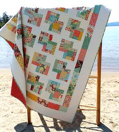 This Quilt is Quick, Easy and Great in Any Color Theme - Quilting Digest. - looks similar to quarter log cabin using background in 2 and rotating this 4 blocks Layer Cake Quilt Patterns, Layer Cake Quilts, Modern Quilt Patterns, Pdf Patterns, Baby Patterns, Block Patterns, Pattern Ideas, Fat Quarters, Kansas