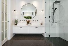 hamptons bathroom hamptons-style-bathroom-with-round-black-mirror-and-grey-diamond-tile-floor Hamptons Style Bedrooms, Hamptons Style Homes, Die Hamptons, Hamptons Decor, Bad Inspiration, Bathroom Inspiration, Bathroom Ideas, Bathroom Inspo, Bathroom Designs