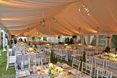 This taffeta tent liner is white, but it reflects the pink and amber lighting. ( #tented wedding, #fabric lining in tent, #tent decor )