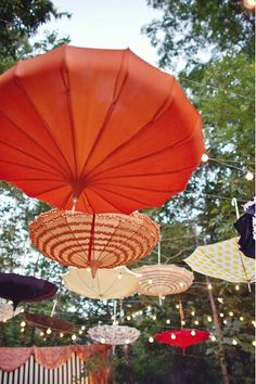 """DIY Hanging Umbrella Decor – hanging a collection of umbrellas or parasols upside down creates an amazing view. {DIY Tip} Suspend paper parasols, vintage or funky umbrellas upside down along a line Umbrella Decorations, Wedding Decorations, Hanging Decorations, Diy Outdoor Party Decorations, Flowers Decoration, Garden Decorations, Decor Wedding, Umbrella Lights, Rain Umbrella"