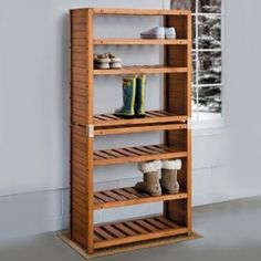 Eucalyptus Shoe Rack | Crafted of natural eucalyptus with an oil finish, this sturdy shoe storage rack makes it easy to keep all types of shoes and boots under control. The slatted shelves of the Eucalyptus Shoe Rack not only look smart, they allow wet footwear to dry faster. This shoe storage rack holds up to 12 pairs on four adjustable shelves. You can also stack two Eucalyptus Shoe Racks to make one large rack; angle brackets and wall anchors included. Shop at SkyMall.com!