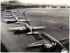U.S. Air Force Douglas C-47 airplanes unloading cargo at Tempelhof Airport, Berlin, Germany during Operation Vittles (Berlin Airlift), 1948-1949. U.S. Air Force Photo,